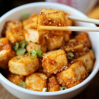 amazing fried tofu with green onions and sesame seeds.